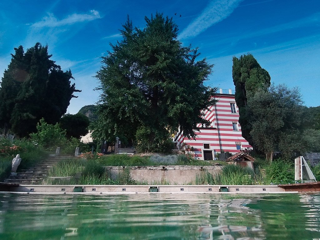 Relais Farmhouse Villa Bissiniga seen from the bio pool at Salò, lake garda Italy.