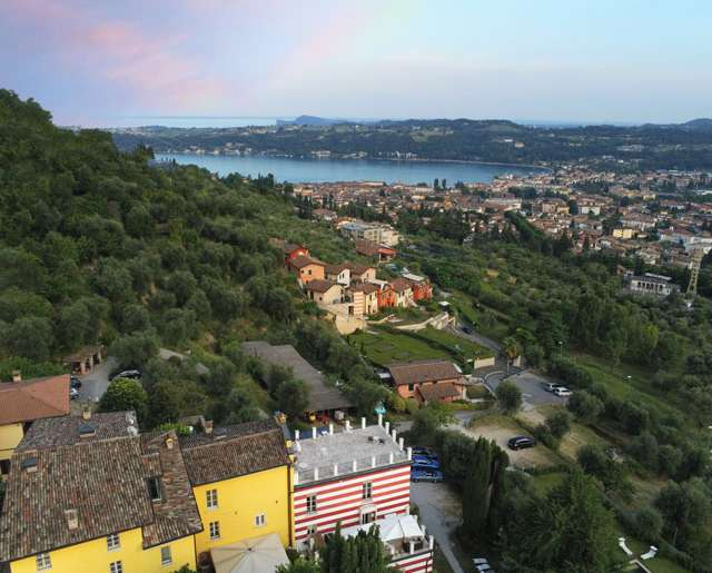 Drone View of Agriturismo Villa Bissiniga over the bay of Salò, Lake Garda, Italy