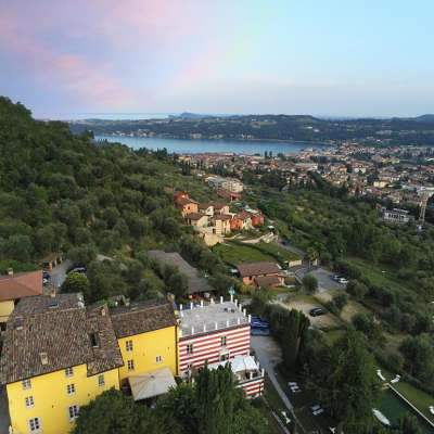 A rose-colored sky above Villa Bissiniga and Salò, a sign of hope